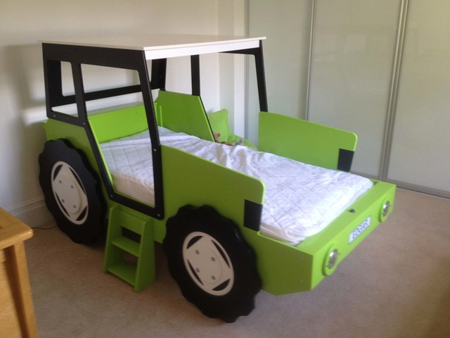 lime green tractor bed with white wheels
